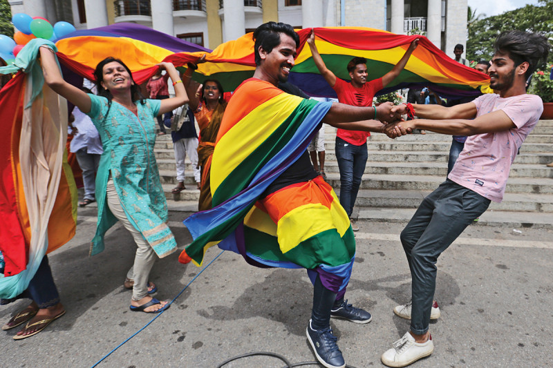 Members of the LGBT community dance to celebrate after the country's top court struck down a colonial-era law that made homosexual acts punishable by up to 10 years in prison, in Bangalore, India, Thursday, Sept. 6, 2018. The court gave its ruling Thursday on a petition filed by five people who challenged the law, saying they are living in fear of being harassed and prosecuted by police